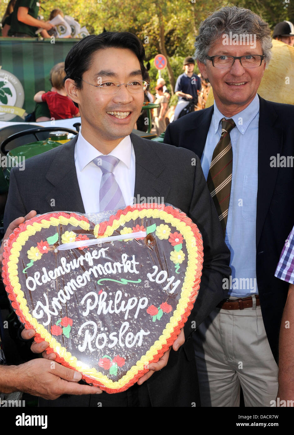 Holding a gingerbread in his hands Economy Minister Philipp Roesler (L) and Oldenburg's mayor Gerd Schwandner - Stock Image