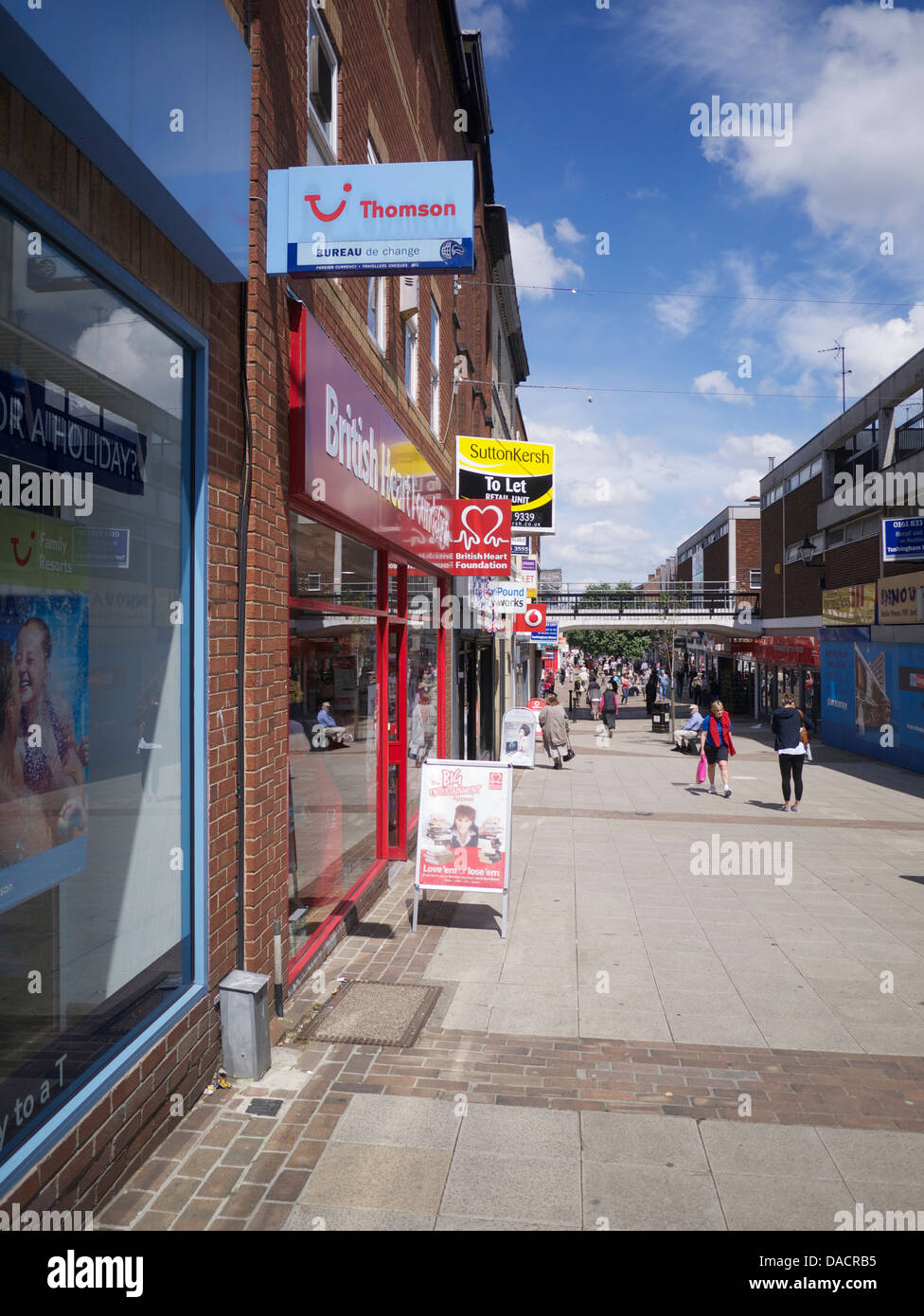Decline of the High Street. A mix of active business, empty & charity shops - Stock Image
