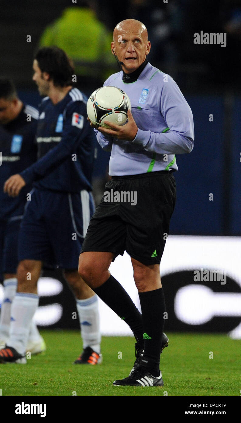 eb2e4e7115f Referee Pierluigi Collina leaves the pitch for half-time during the charity  soccer match against