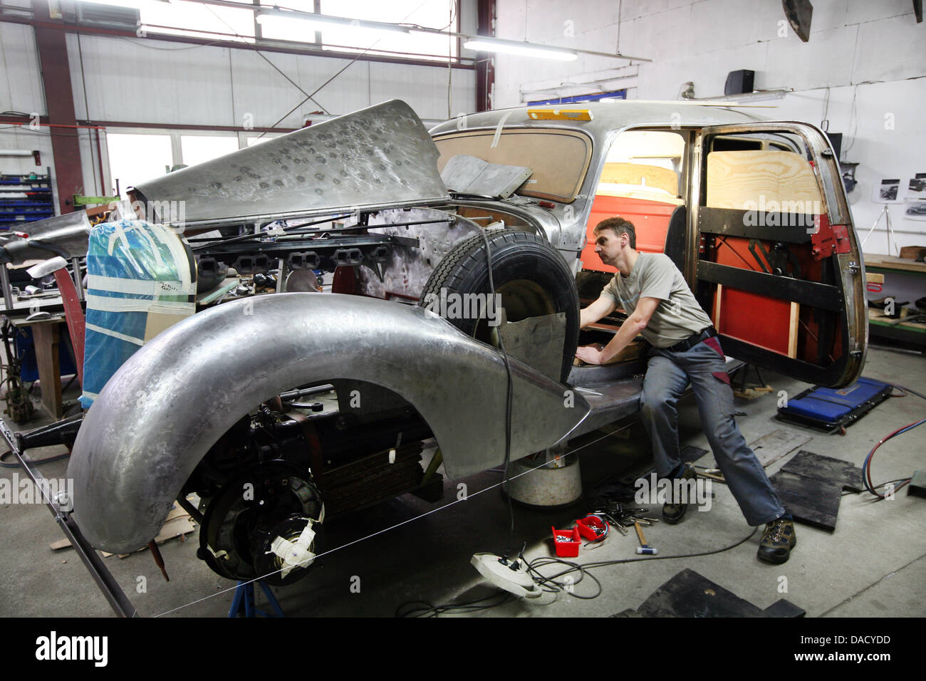 Automobile Mechanic Peter Spillner Works On The Car Body Of A Mercedes Benz  770 From