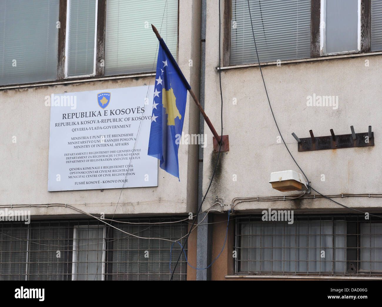 Next to a sign the national flag is seen at the Ministry of Internal Affairs with the 'Department of Registration Stock Photo