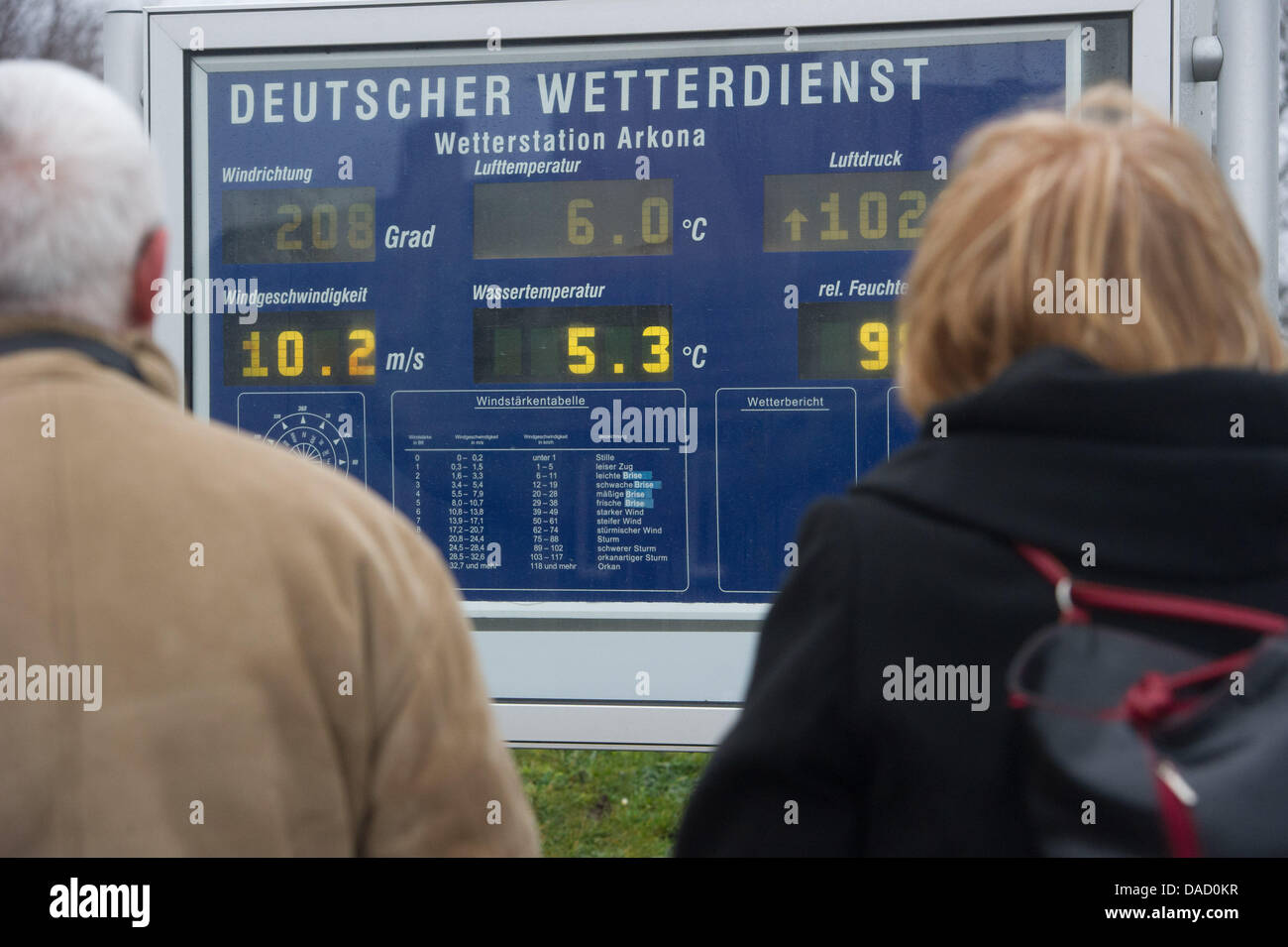 Tourists look at an indicator panel of the German Weather Service at Cape Arkona in Putgarten, Germany, 28 December - Stock Image