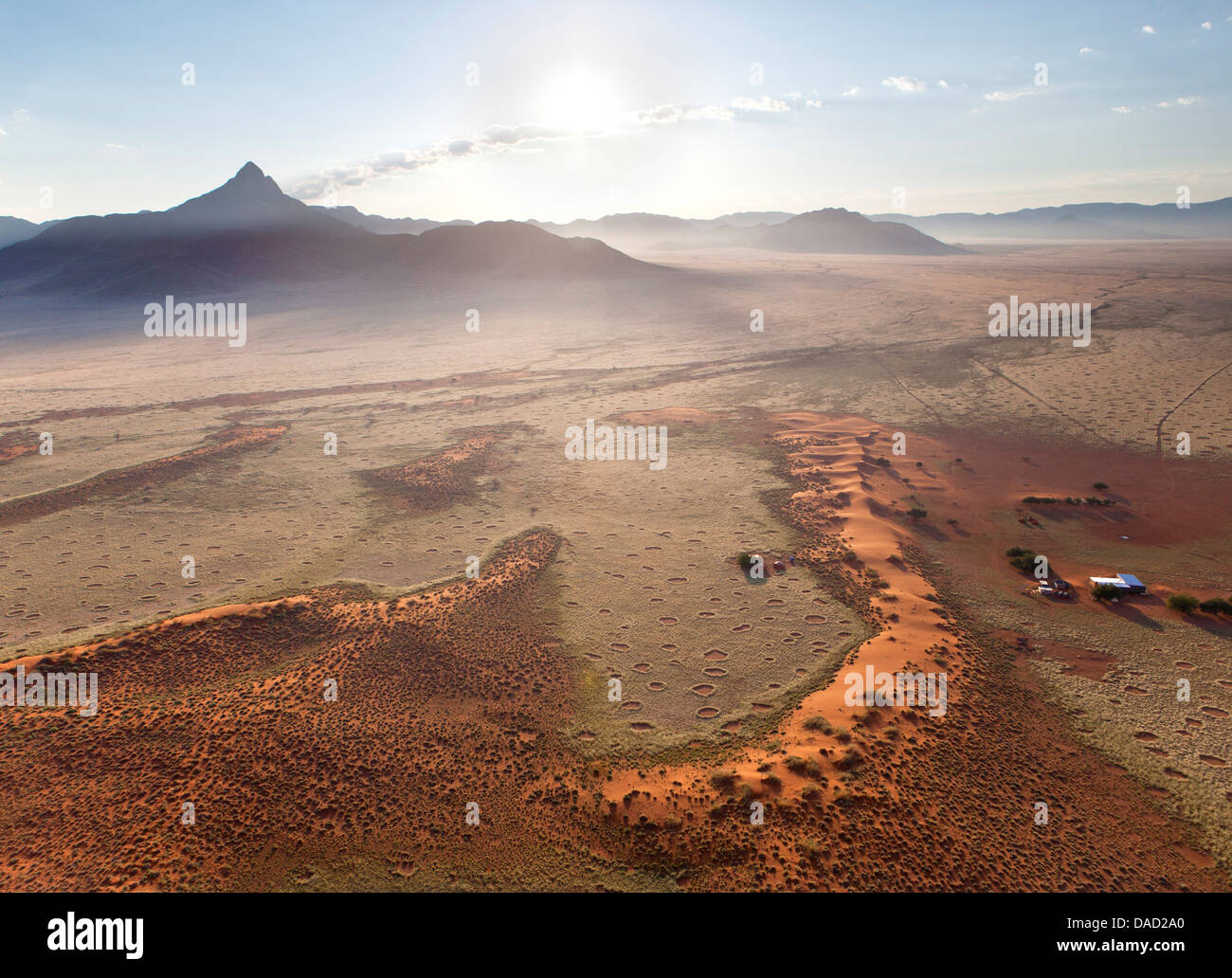 Aerial view from hot air balloon of mountains and Fairy Circles, Namib Rand game reserve Namib Naukluft Park, Namibia - Stock Image
