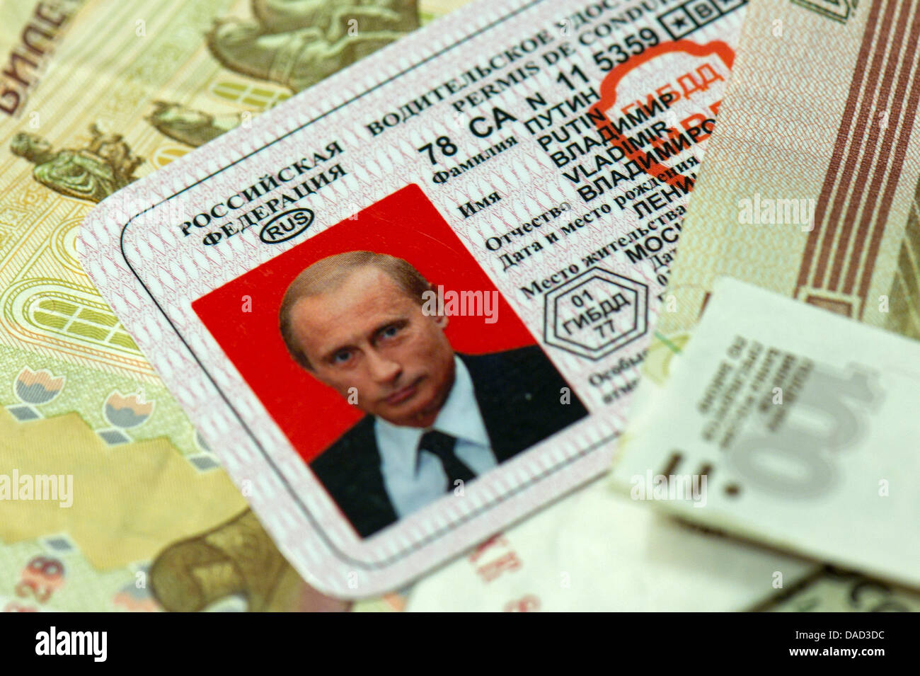ILLUSTRATION - A faked drivers license of the Russian Prime Minister Vladimir Putin lies on Russian money after - Stock Image