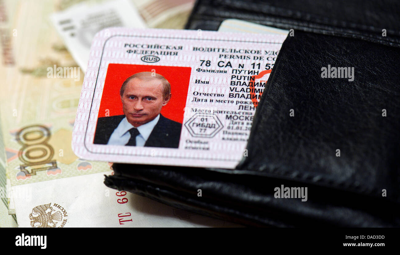 ILLUSTRATION - A faked drivers license of the Russian Prime Minister Vladimir Putin has been put in a wallet after - Stock Image