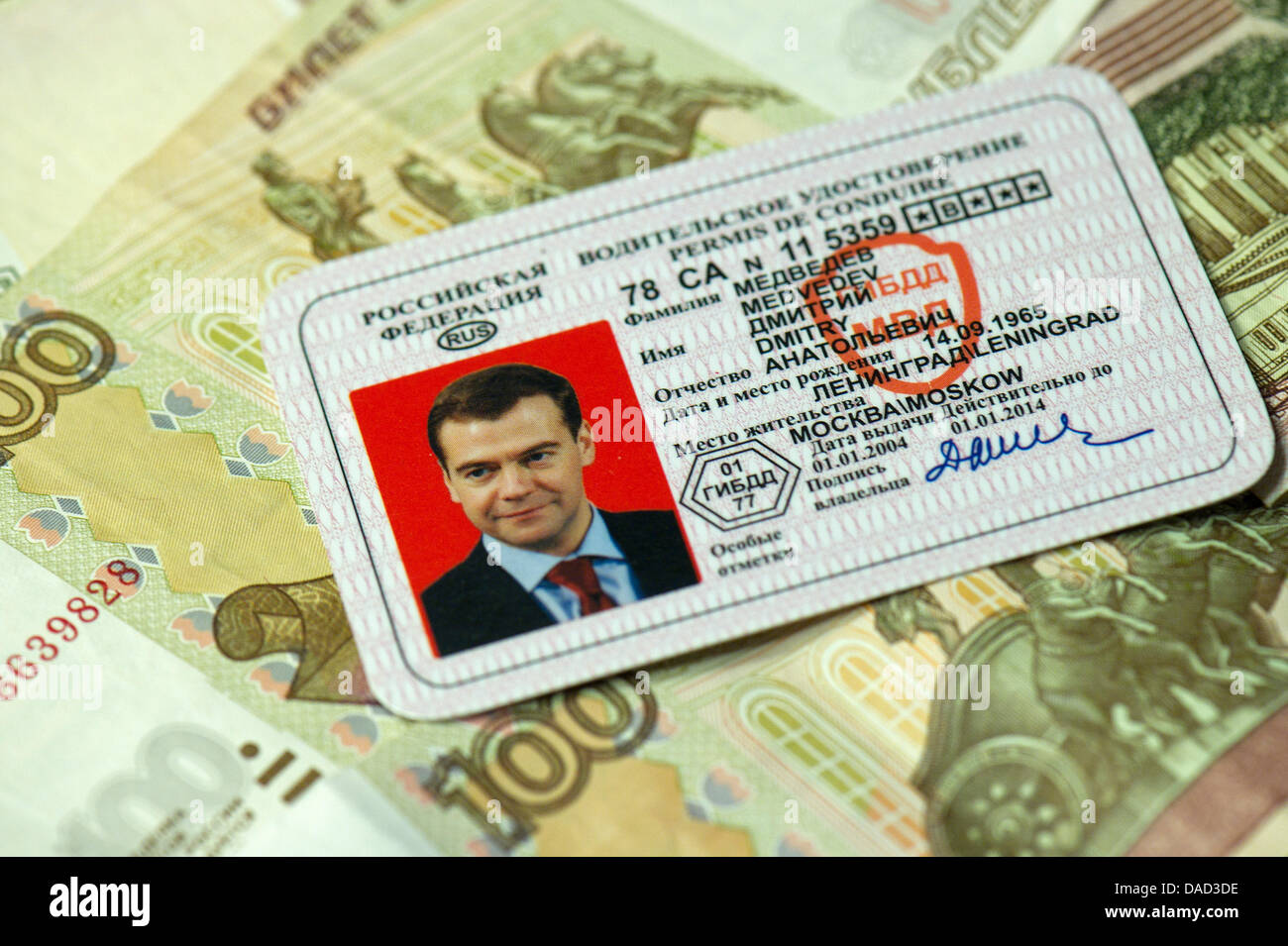 ILLUSTRATION - A faked drivers license of the Russian President Dmitry Medvedev lies on Russian money after being - Stock Image