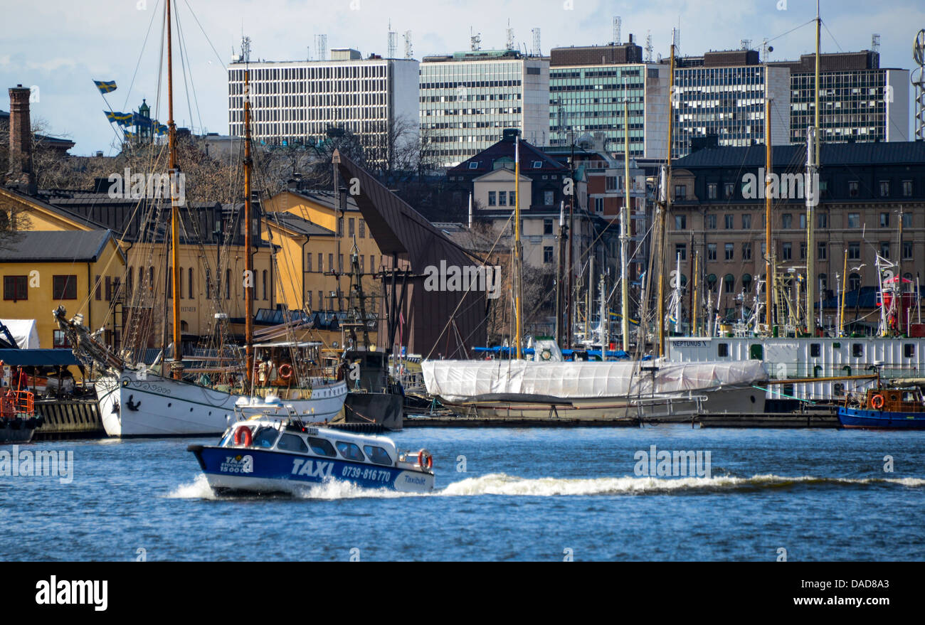 A taxi-boat plies the harbor of Stockholm Sweden - Stock Image