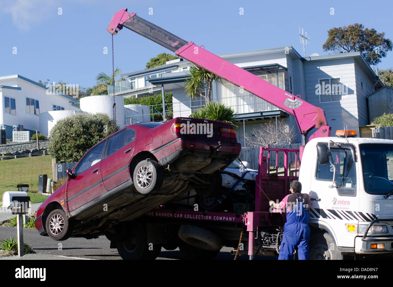 Man towing damaged car over a tow truck on July 01 2013.Many tow companies have the capability to store vehicles Stock Photo