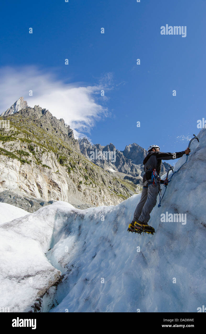 Ice climber at Mer de Glace glacier, Chamonix, Haute-Savoie, French Alps, France, Europe - Stock Image