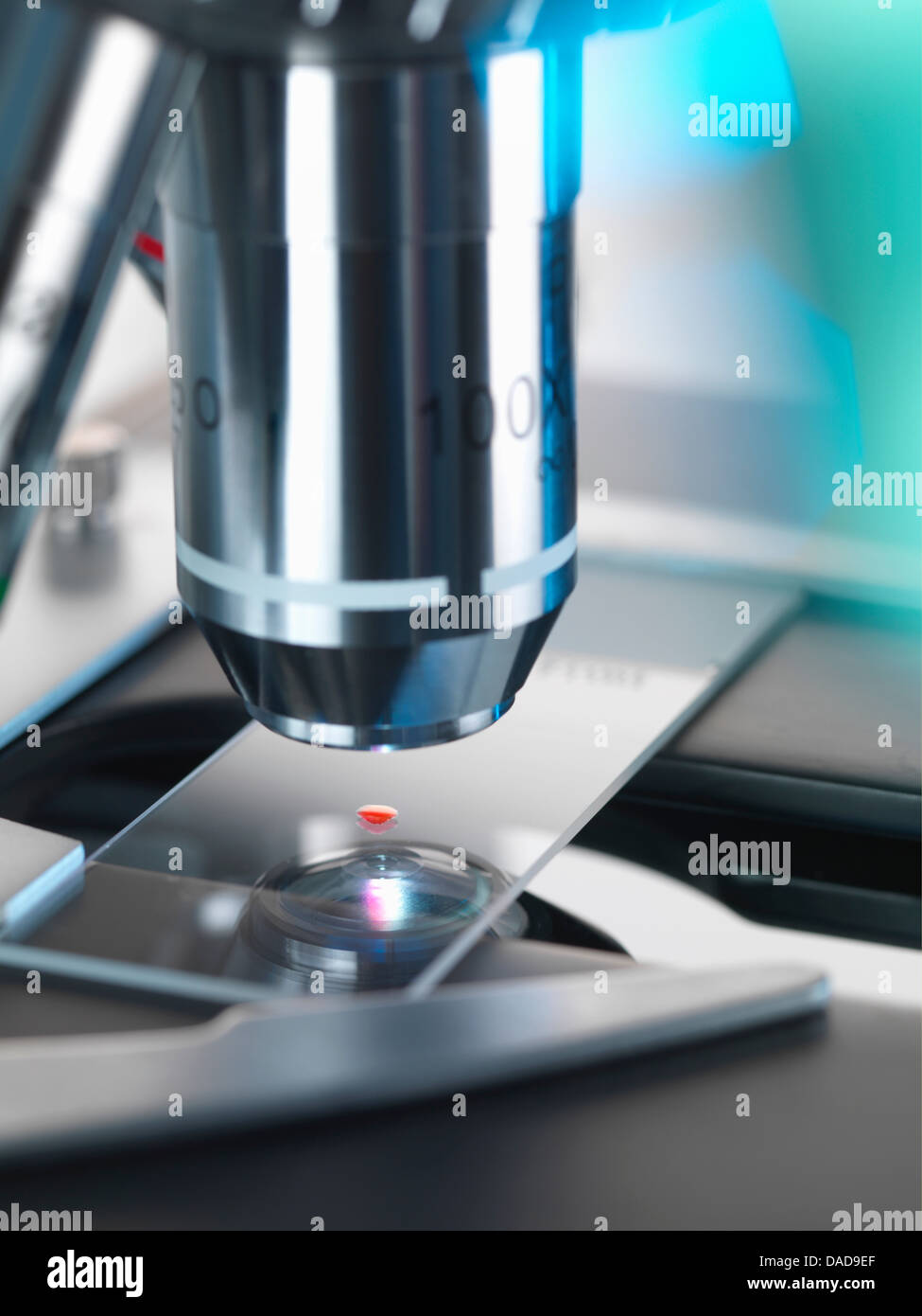 Blood testing, A light microscope examining a sample of blood in a lab - Stock Image