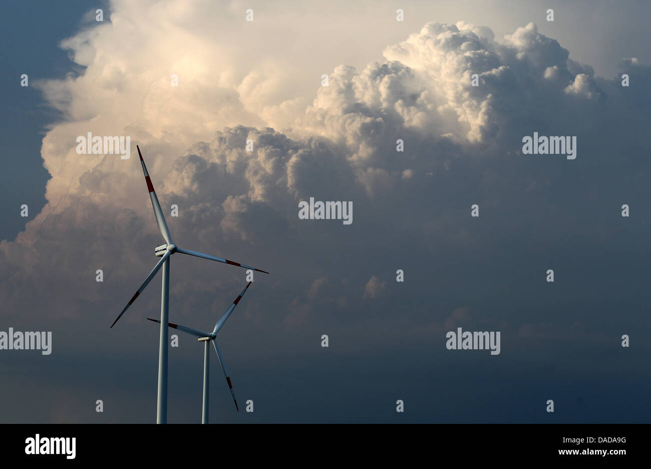 (FILE)An archive photo dated 24 August 2011 shows a storm front behind wind turbines near Loebejuen,Germany, - Stock Image