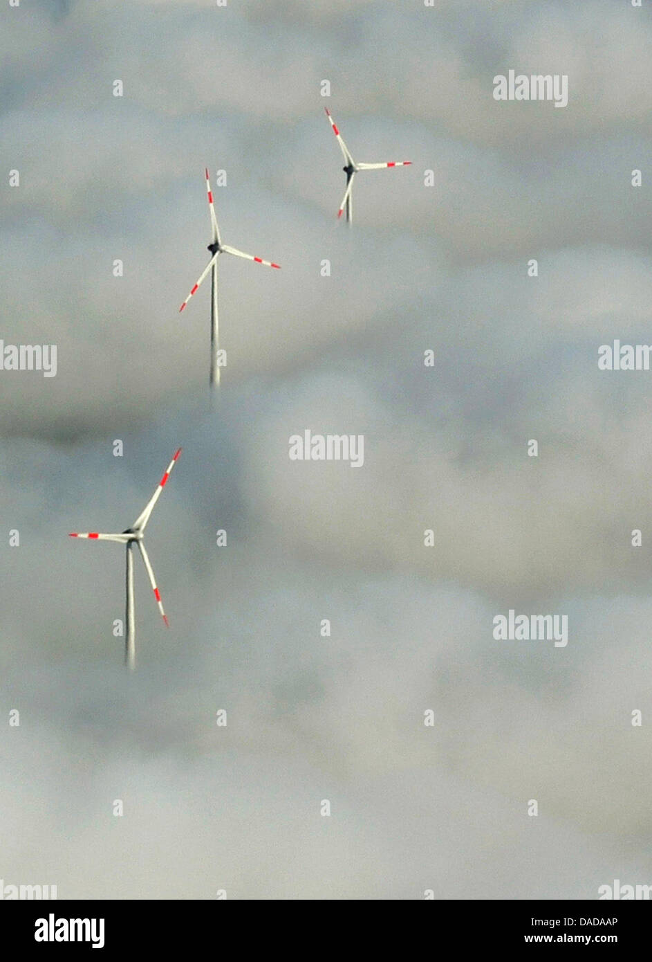 (FILE)An archive photo dated 09 October 2011 shows wind turbines sticking out of the morning fog, photographed - Stock Image