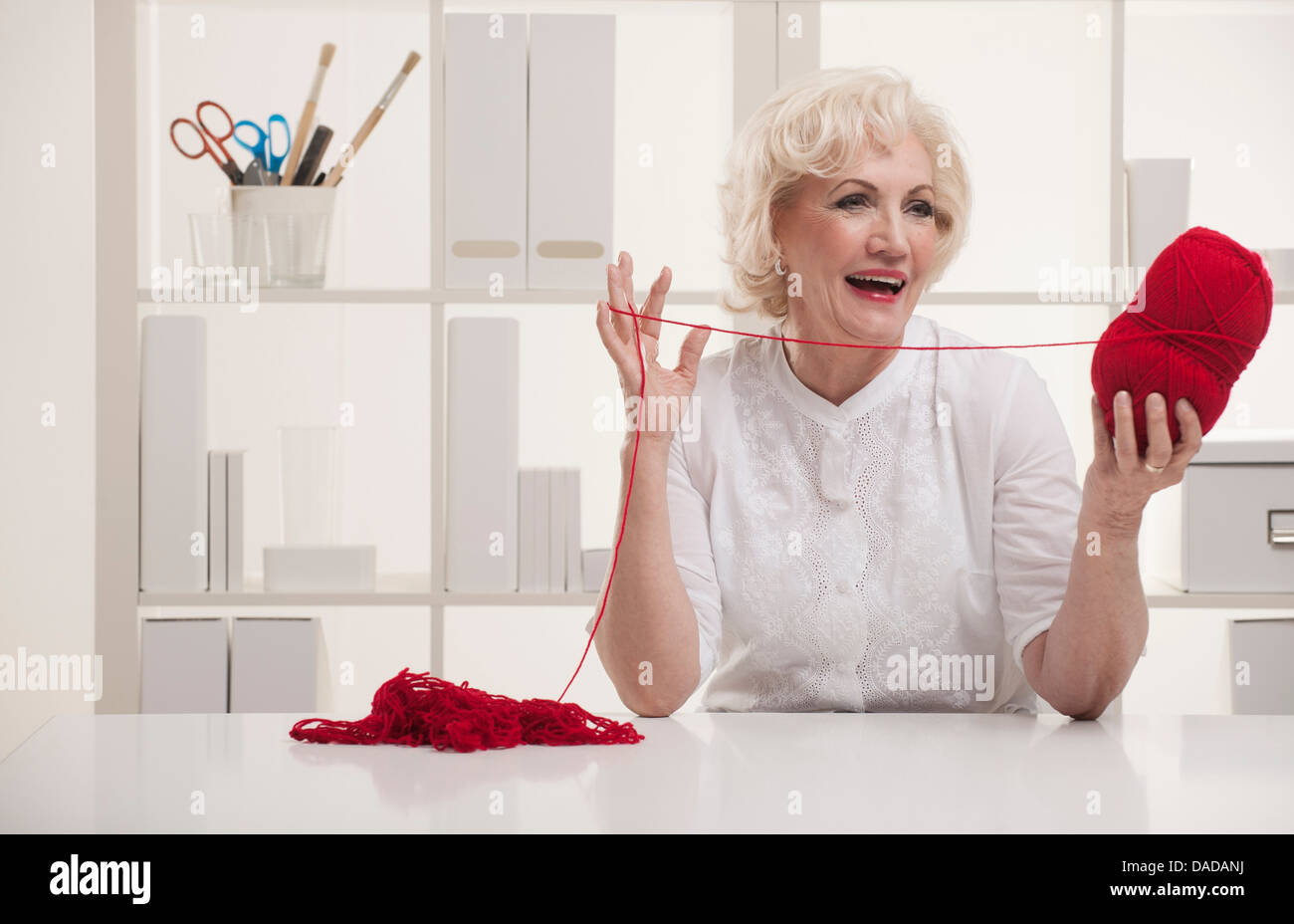 Senior woman with wool - Stock Image