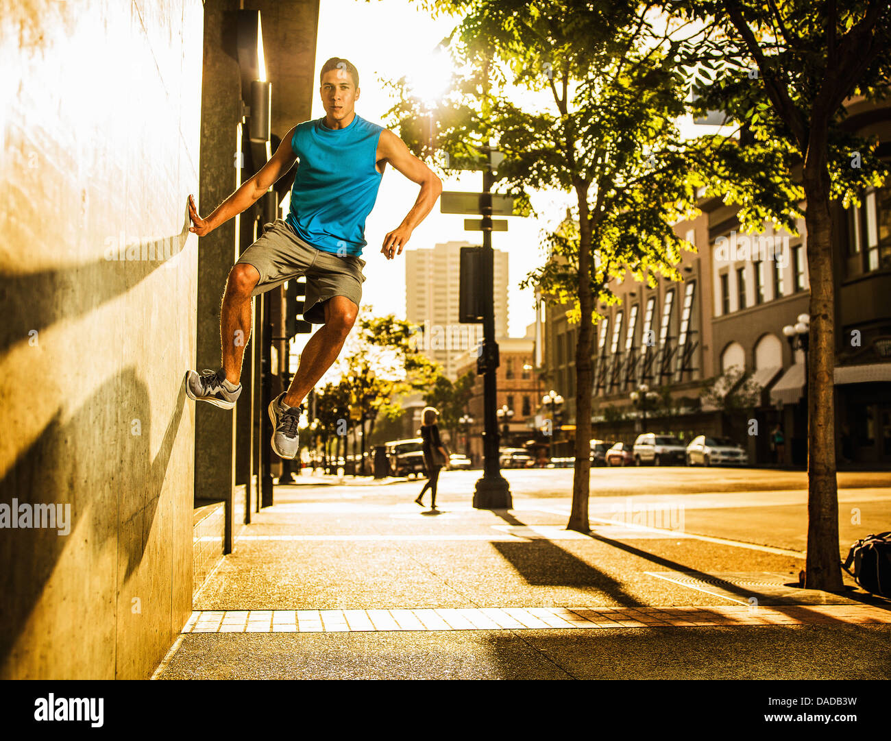 Young man practising parkour - Stock Image