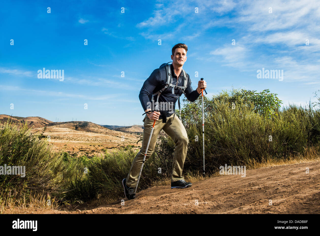 Male hiker in rural setting - Stock Image