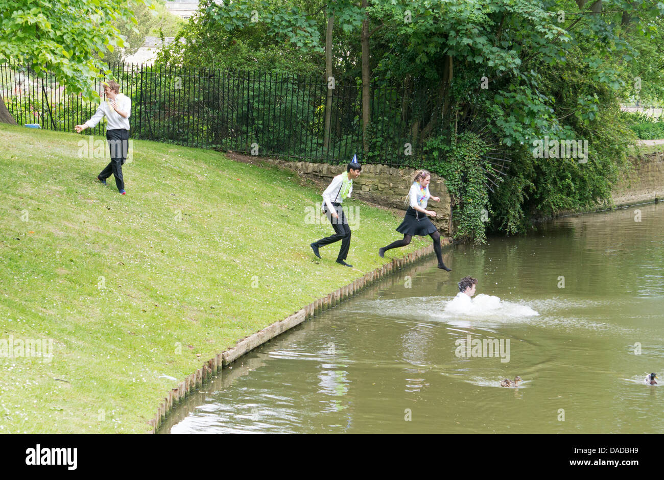 Oxford University students celebrate completion of final exams by jumping in river - Stock Image