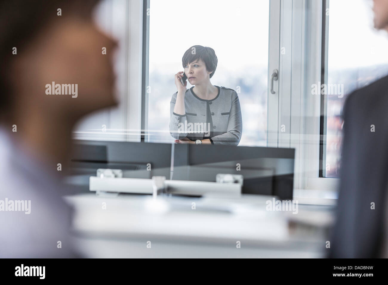 Businesswoman making telephone call - Stock Image
