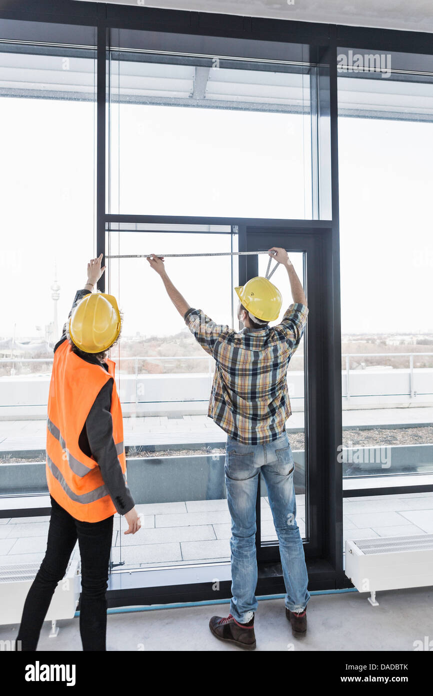 Builders measuring window - Stock Image