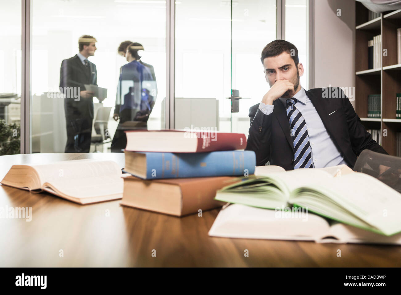 Male lawyer with hand on chin - Stock Image