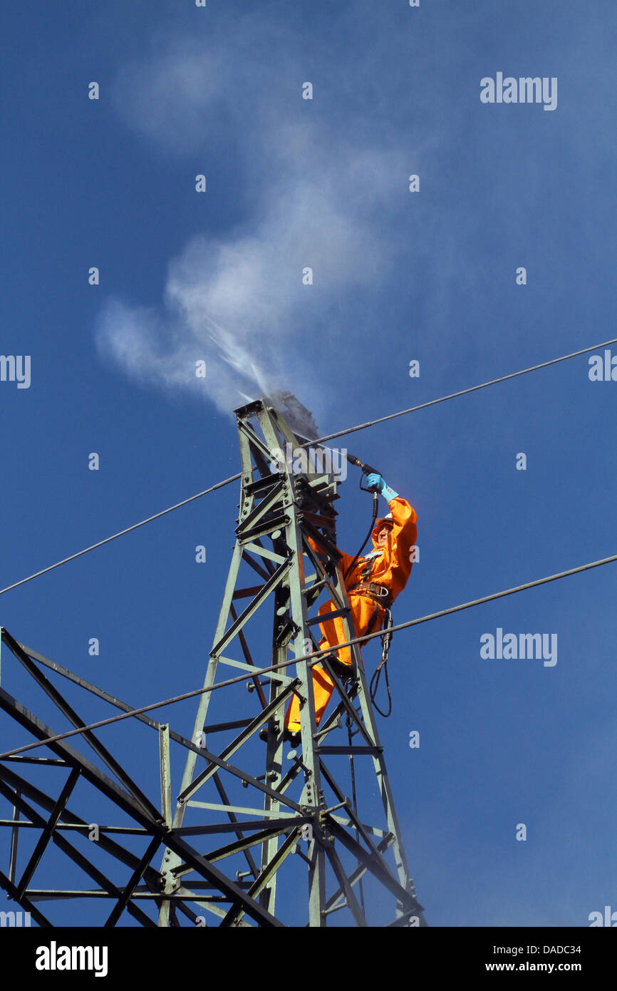 sandblasting a power pole, Germany - Stock Image