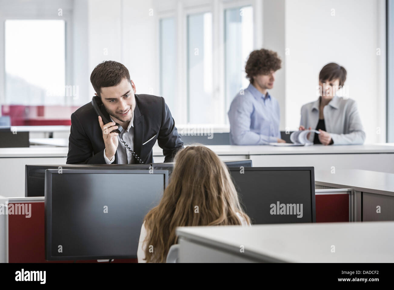 Businesspeople working in office - Stock Image