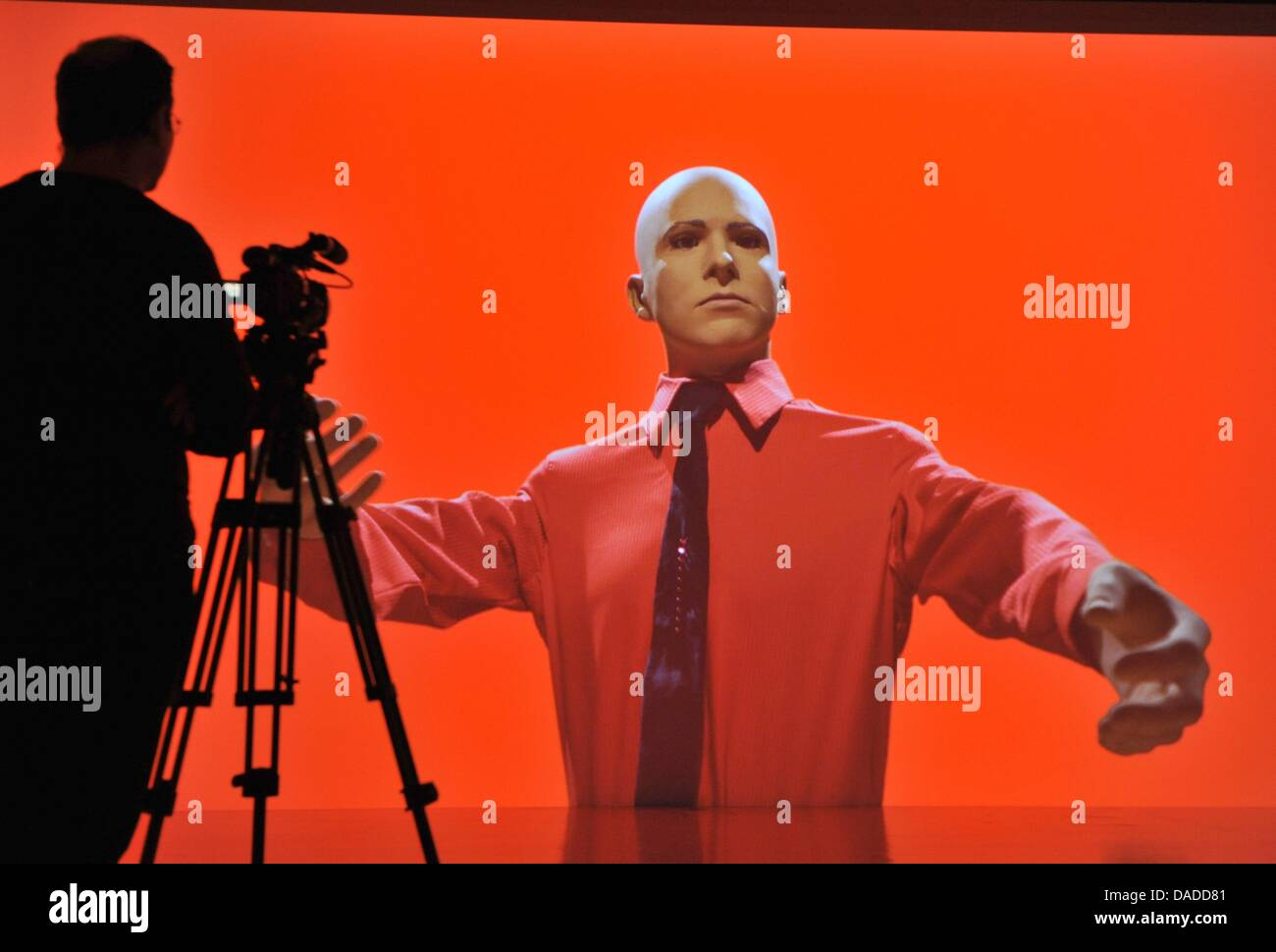 A camera man films a 3D video installation, in which a musician from the band Kraftwerk is seen, during the video Stock Photo