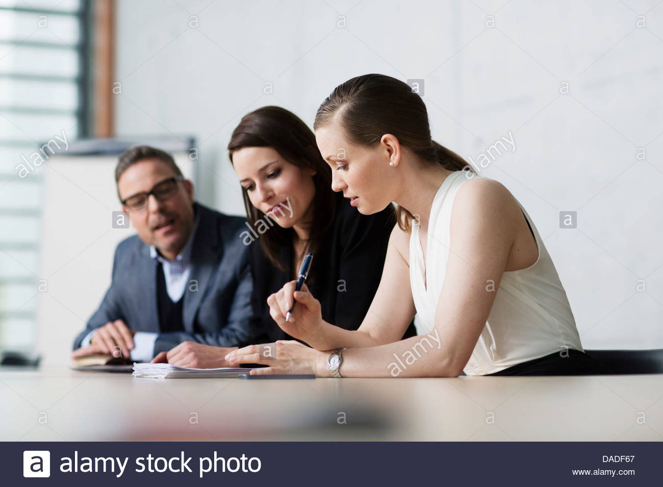 Three people in meeting - Stock Image