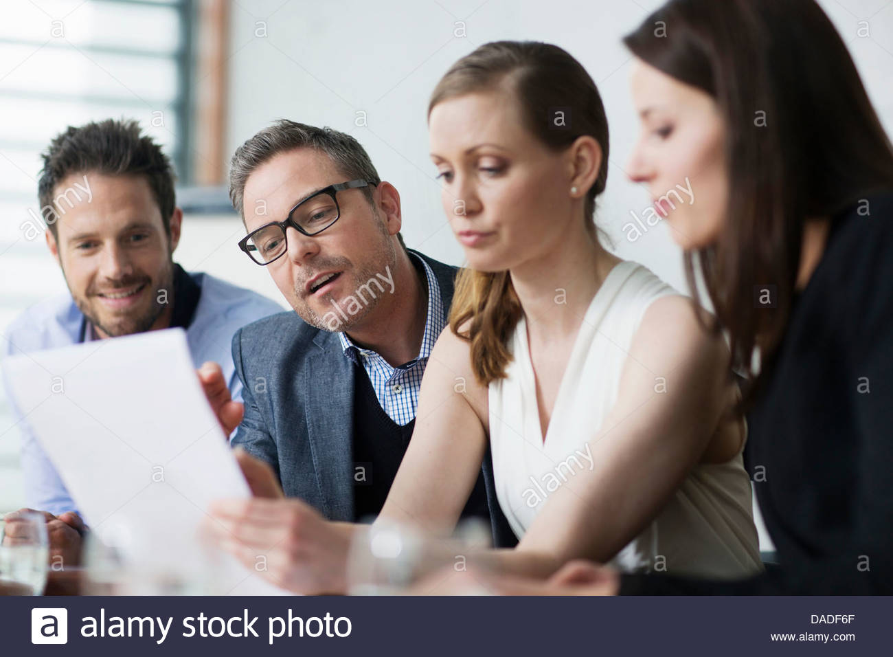 Four people in meeting Stock Photo