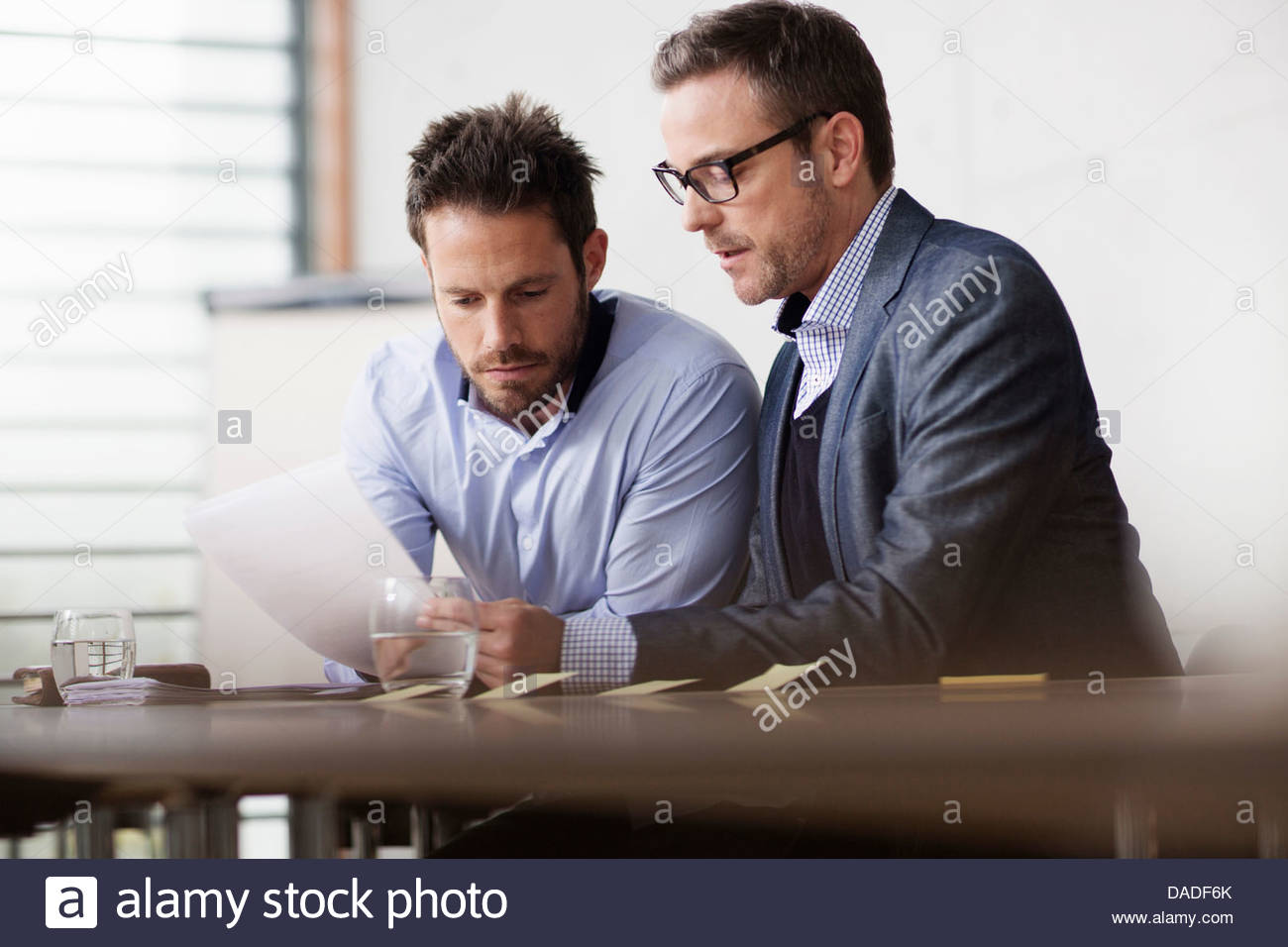 Two men in serious discussion - Stock Image