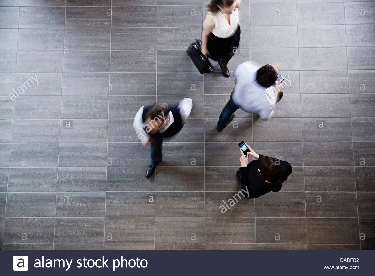 Four people walking away - Stock Image