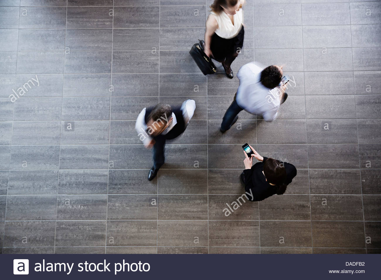 Four people walking away Stock Photo