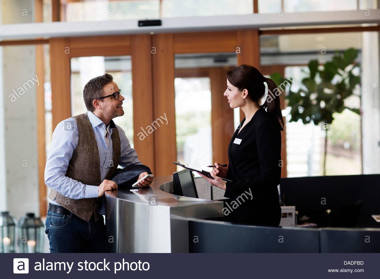 Man and woman talking - Stock Image