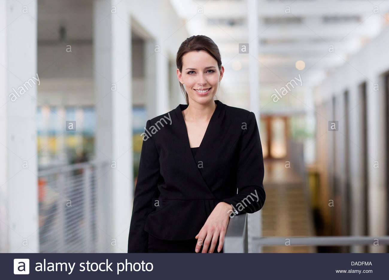 Woman looking at camera - Stock Image