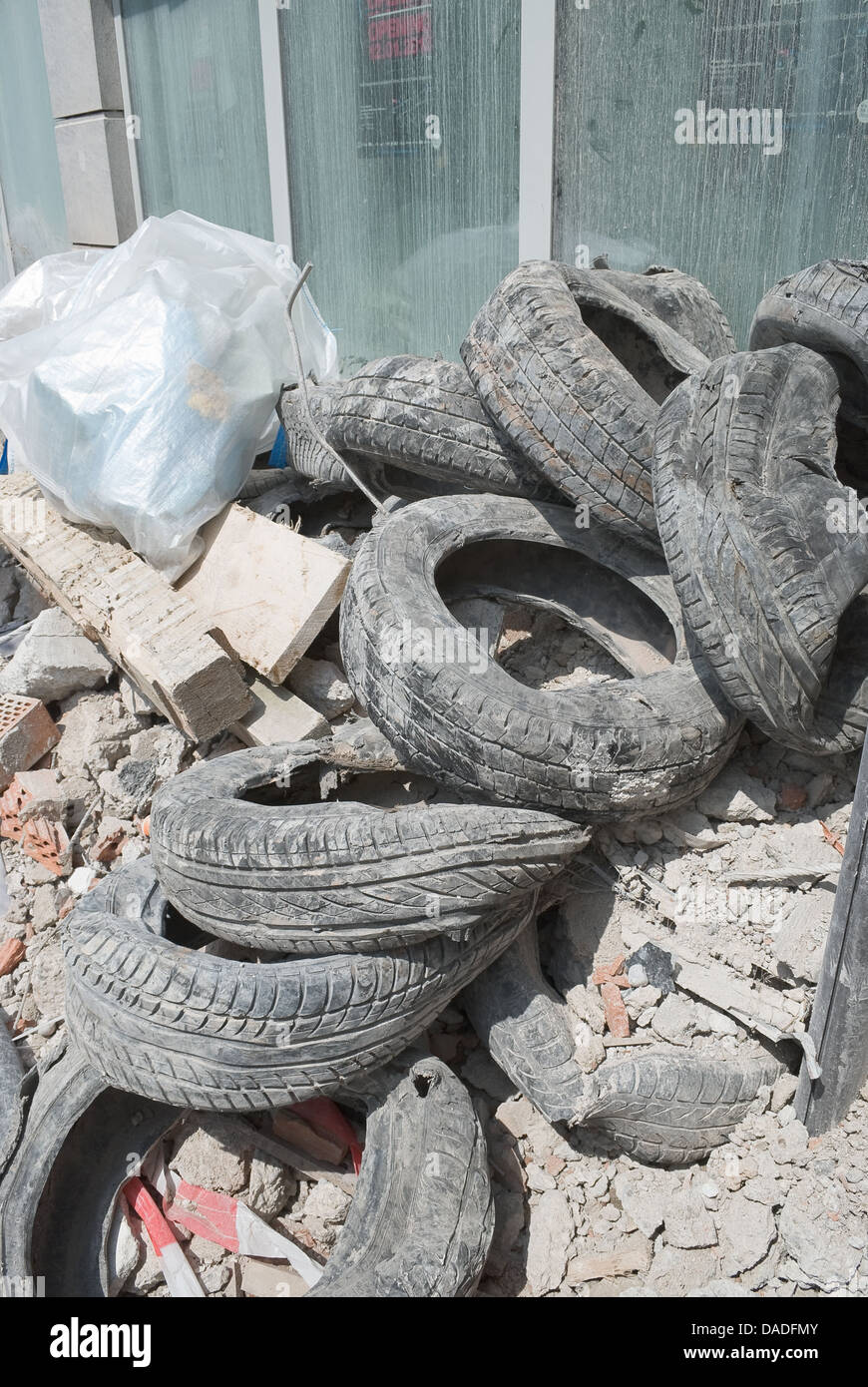 Rubble and Old Tires from Demolition as Sign of Urban Renewal - Stock Image
