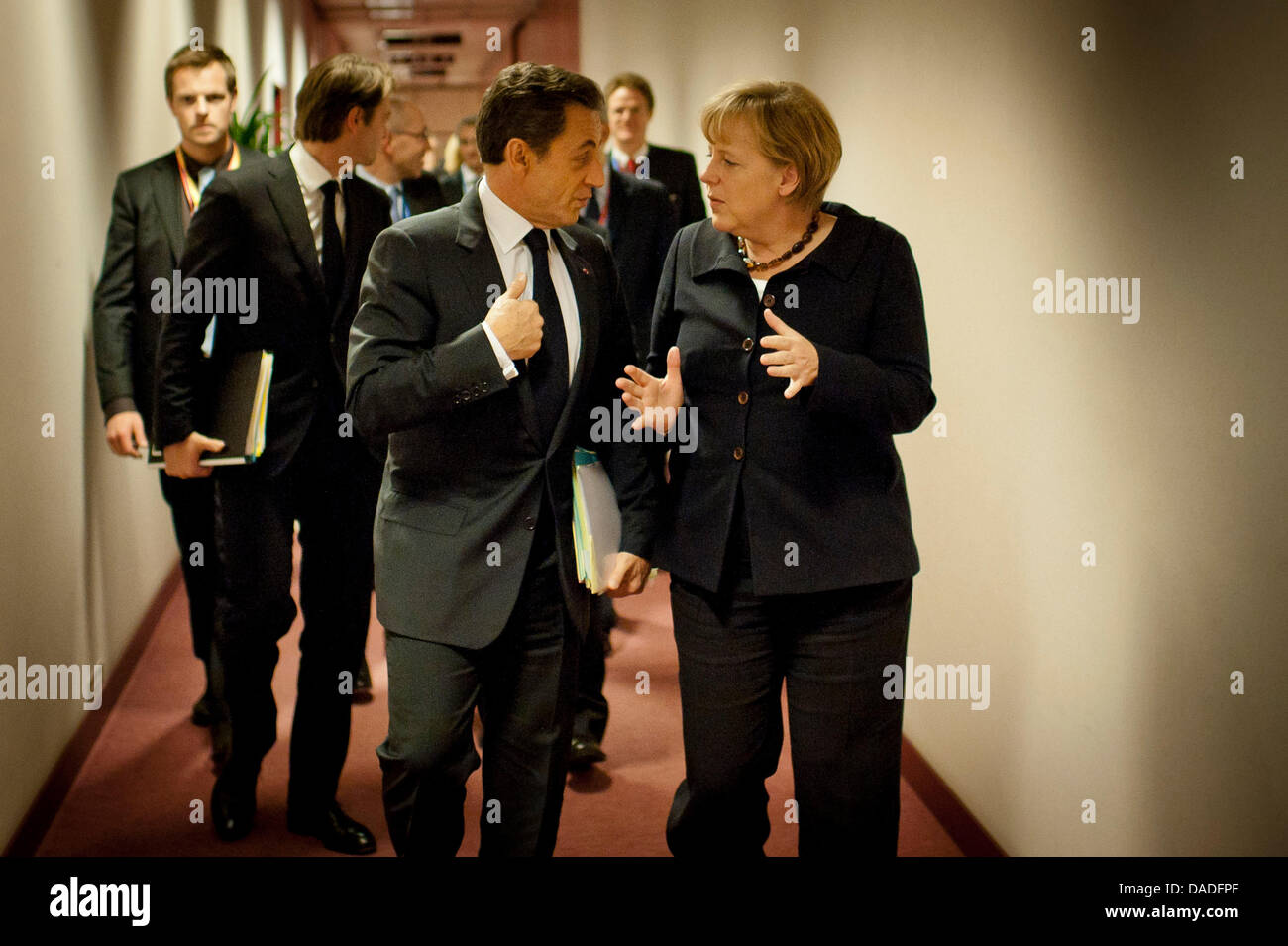 German Chancellor Angela Merkel (CDU) and French President Nicolas Sarkozy talk in a corridor of the Council of - Stock Image
