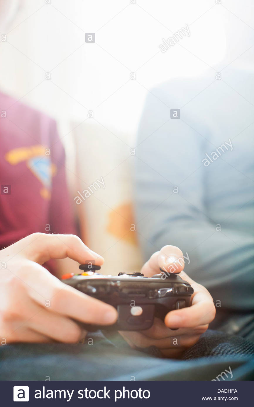 Father and grown up son playing video game - Stock Image