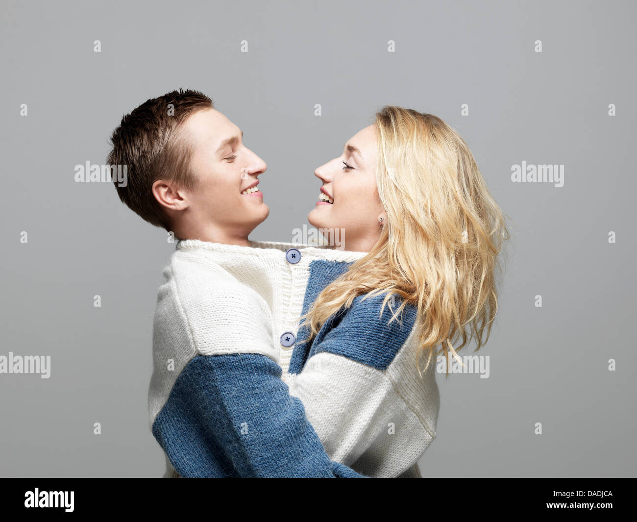 Young couple wearing same sweater - Stock Image