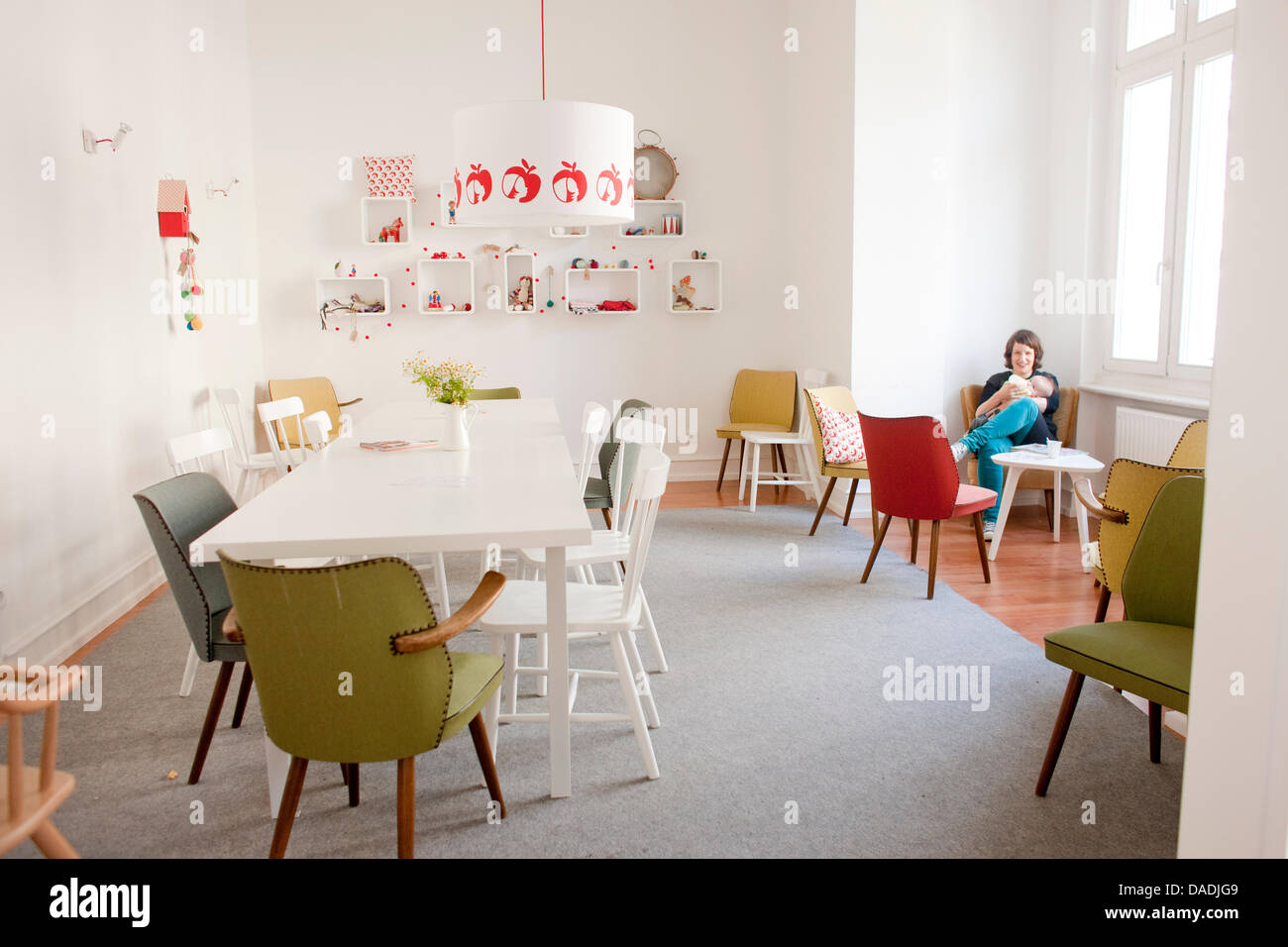 A Young Mother Sits In The Cafe Apfelkind Apple Child In Bonn