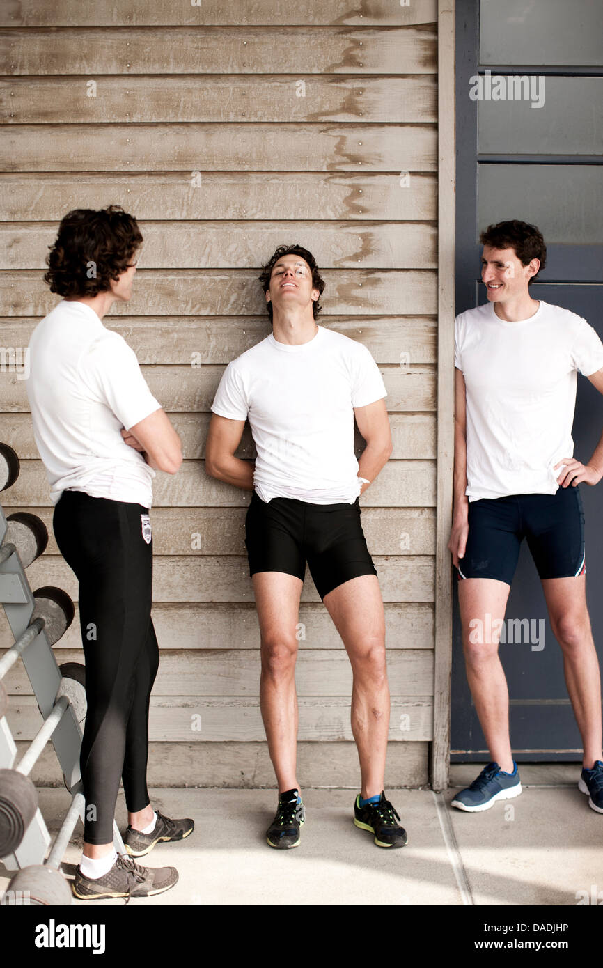 Men relaxing after workout - Stock Image
