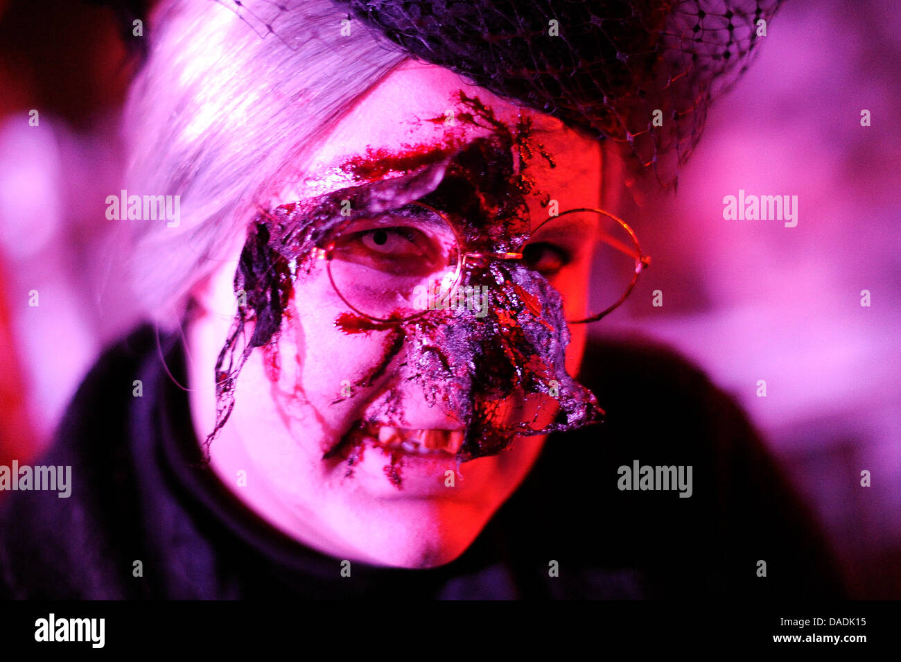 An actress costumed as monster scares visitors of the MoviePark in Bottrop, Germany, 27 October 2011. With Christmas - Stock Image