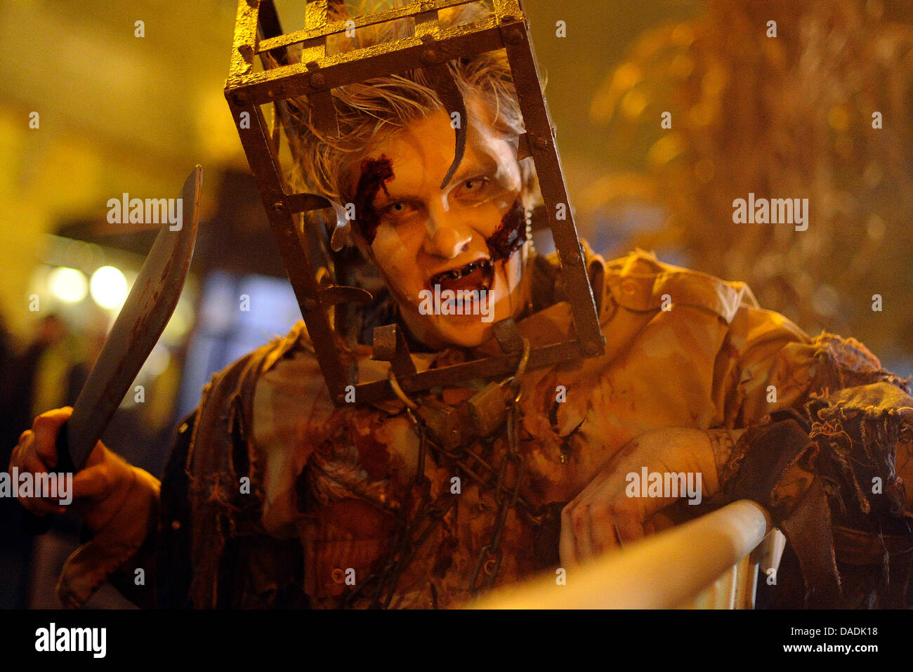 A performer costumed as monster scares visitors of the MoviePark in Bottrop, Germany, 27 October 2011. With Christmas - Stock Image