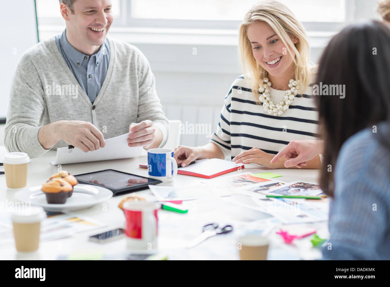 Creative team discussing plans in office meeting - Stock Image
