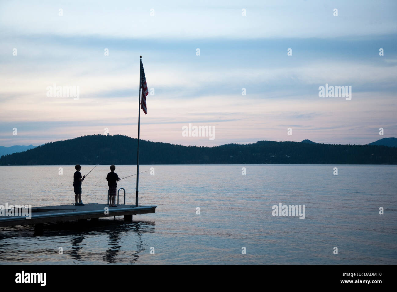 Boys fishing, Lake Pend Oreille, Idaho, USA - Stock Image