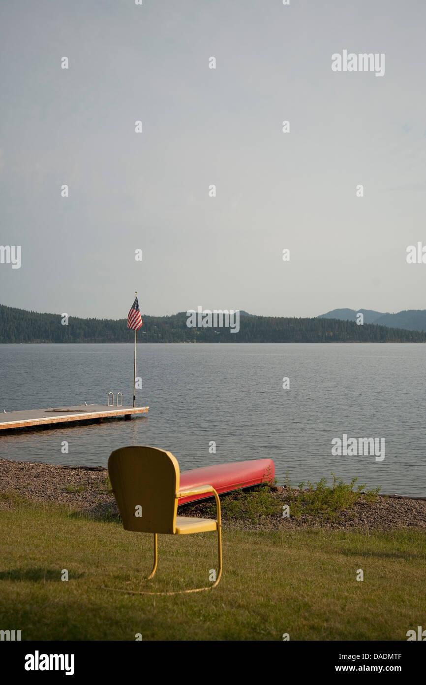 Empty chair, Lake Pend Oreille, Idaho, USA - Stock Image