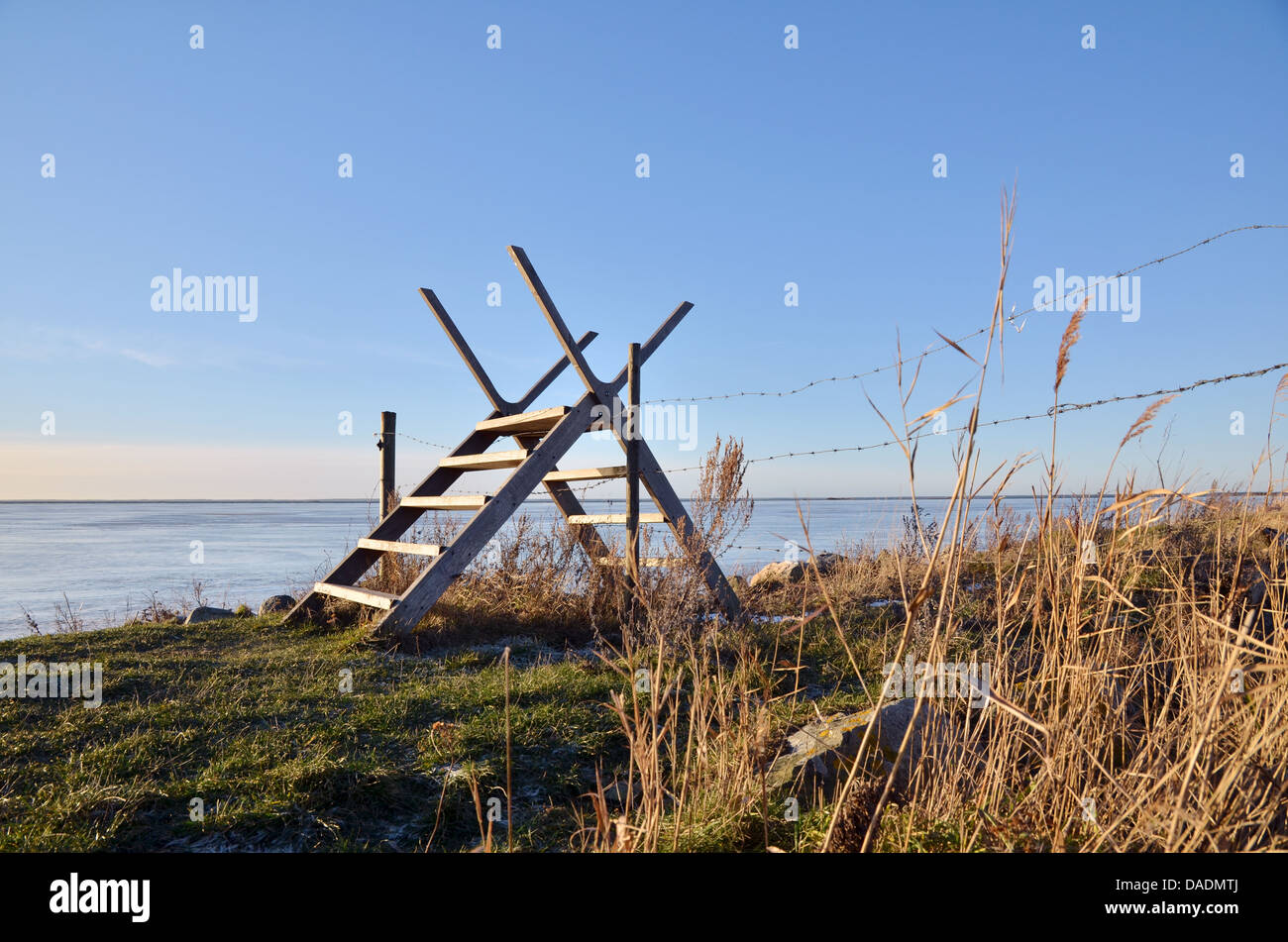 Stile over barb wire - Stock Image