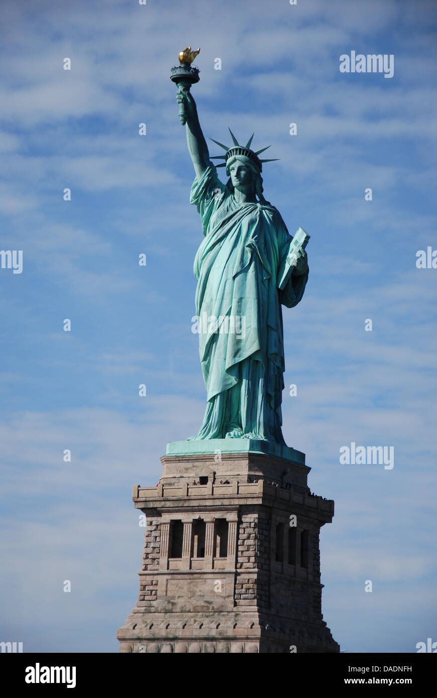 The Statue Of Liberty Stands In The Harbour Of New York City
