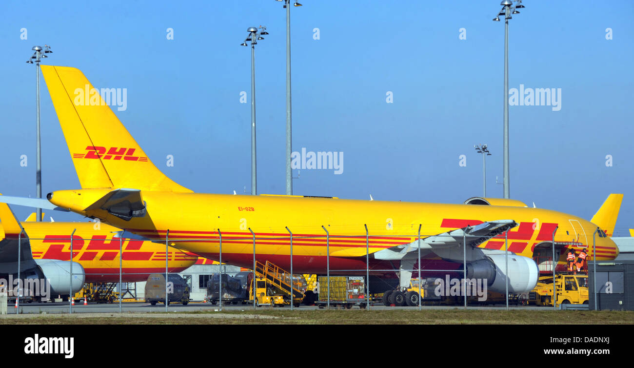 a cargo plane of the mail service dhl is loaded at the airport stock photo 58080250 alamy. Black Bedroom Furniture Sets. Home Design Ideas