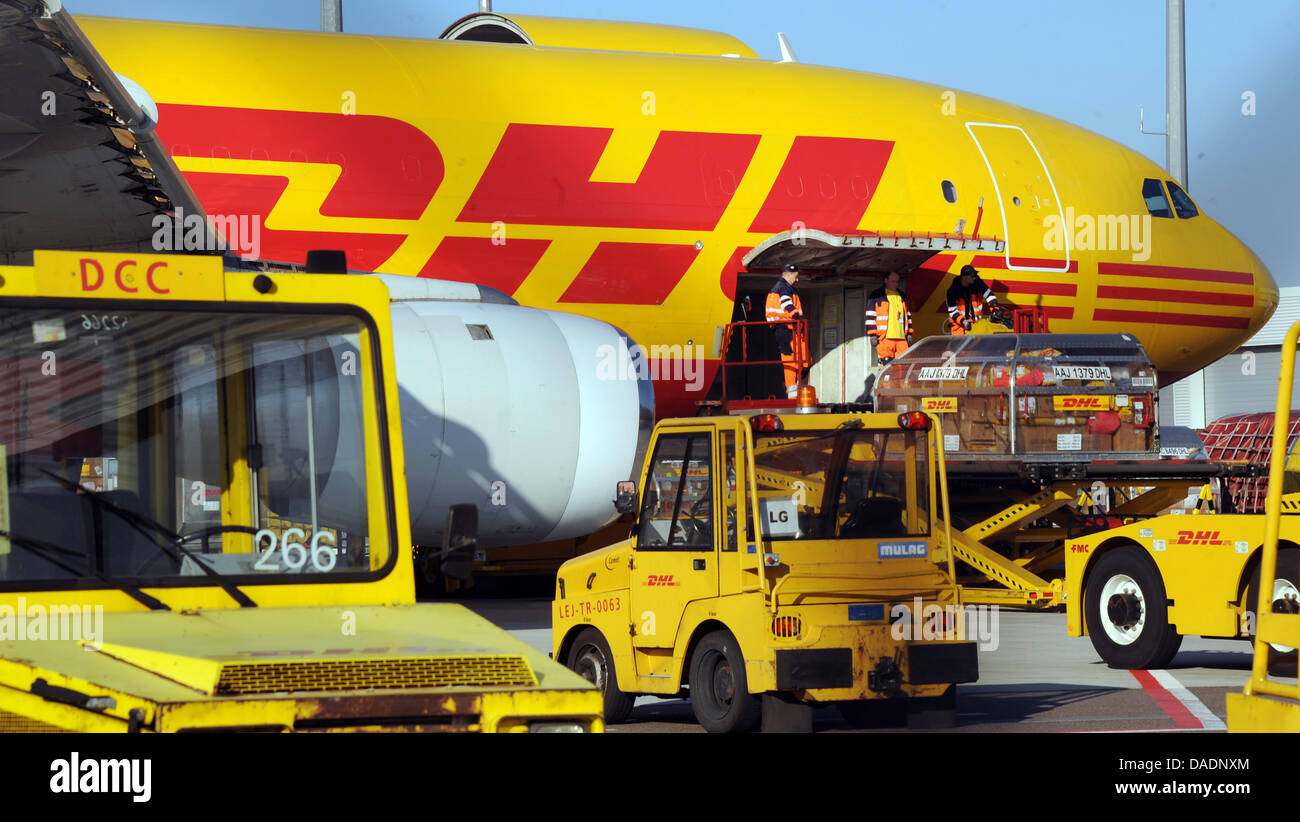 a cargo plane of the mail service dhl is loaded at the airport stock photo 58080252 alamy. Black Bedroom Furniture Sets. Home Design Ideas