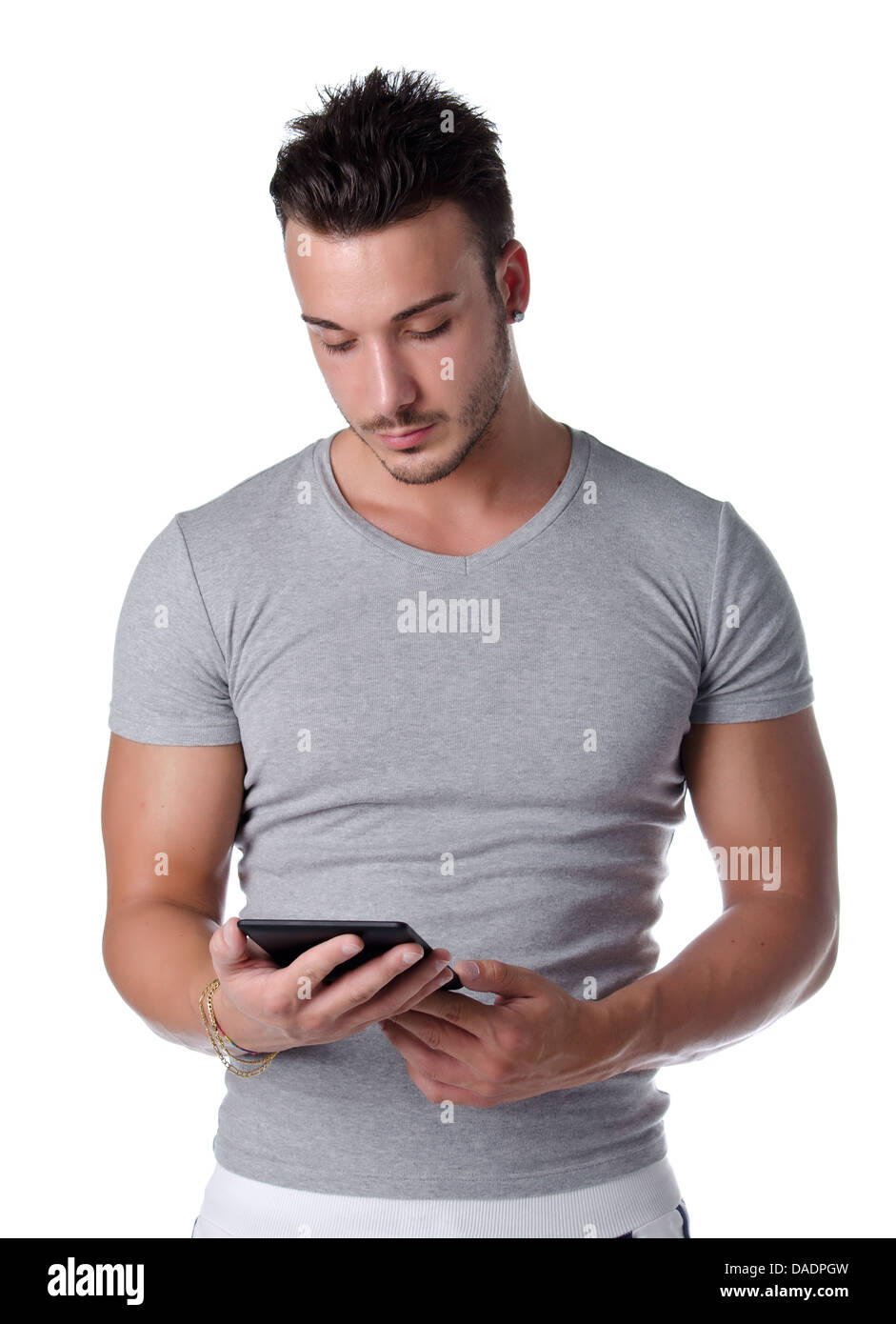 Handsome and fit young man using ebook reader, isolated on white background Stock Photo