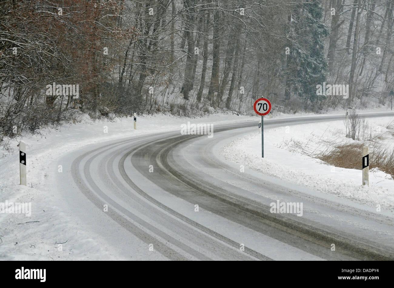 snow-slicked road in shower of sleet, Germany, Baden-Wuerttemberg, Swabian Alb, Kleines Lautertal - Stock Image